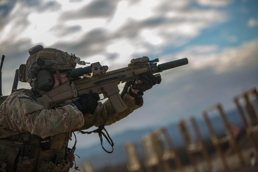 A U.S. Army Ranger from B Company, 2nd Battalion, 75th Ranger Regiment, fires a Special Operations Forces Combat Assault Rifle (SCAR) during a close quarter marksmanship range in Fort Hunter Liggett, Calif., Jan. 25, 2014. (U.S. Army Photo by Pfc. Rashene Mincy/Released) Photo retrieved from DVIDS