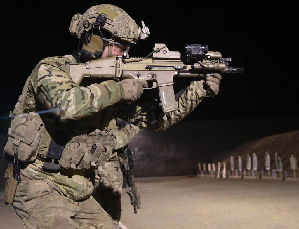A coalition forces member fires his Special Operations Forces Combat Assault Rifle (SCAR) during marksmanship training on a range on Kandahar Air Field, in Kandahar Province, Afghanistan, on Jan 15, 2014. Coalition forces qualified with various weapon systems to maintain their proficiency. (U.S. Army Photo by Pfc. Dacotah Lane/ Released)