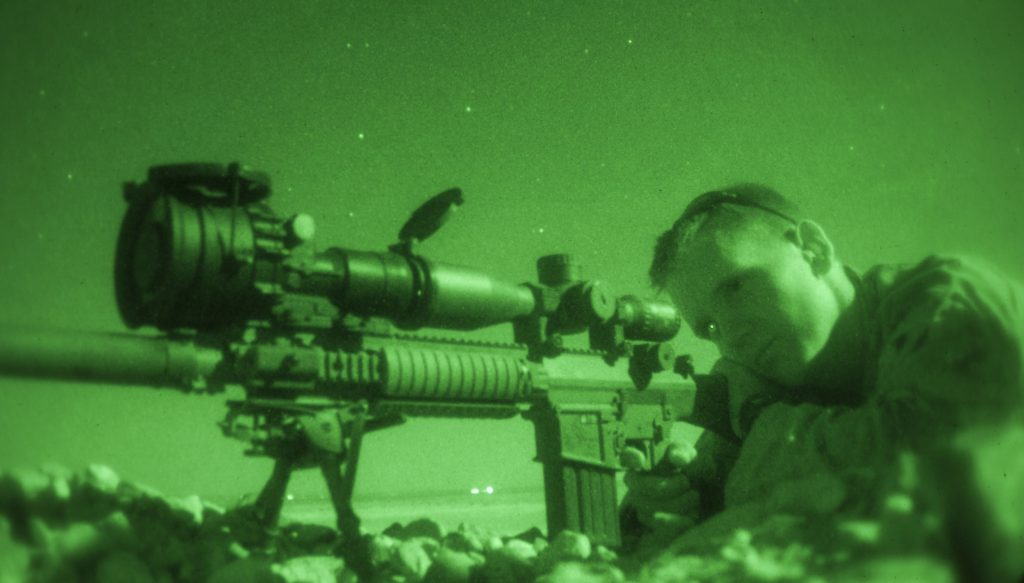 U.S. Marine Sgt. Christopher Stone, a combat cameraman assigned to 26th Marine Expeditionary Unit fires an M110 Semi-Automatic Sniper System during a nighttime live fire in Jordan, June 21, 2013. Exercise Eager Lion 2013 is an annual, multinational exercise designed to strengthen military-to-military relationships and enhance security and stability in the region by responding to modern-day security scenarios. The 26th MEU is a Marine Air-Ground Task Force forward-deployed to the U.S. 5th Fleet area of responsibility aboard the Kearsarge Amphibious Ready Group serving as a sea-based, expeditionary crisis response force capable of conducting amphibious operations across the full range of military operations. (U.S. Marine Corps photograph by Sgt. Christopher Q. Stone, 26th MEU Combat Camera/Released)